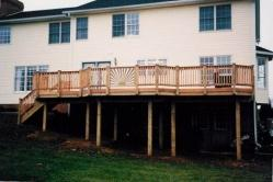 Sunburst rail in treated deck