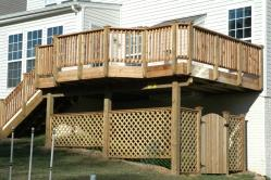 Wood deck with trellis storage area