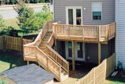 Upper level treated deck with multiple level stair case