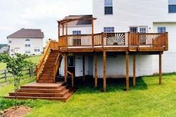 Wood deck with sunburst rail and multi step platform